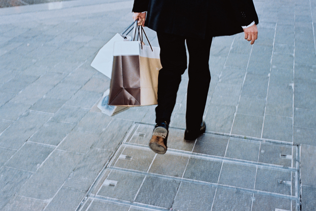 man holding shopping bag